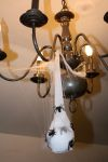Chandelier covered in spider egg sac and web
